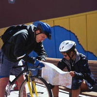 Bicyclists looking at a map