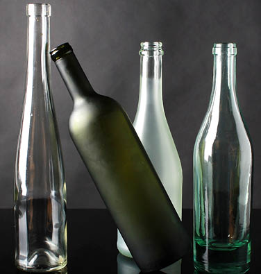 Four clean and empty glass bottles